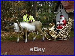 Deko Weihnachtsmann mit Deco Schlitten und Deko Rentier lebensgross