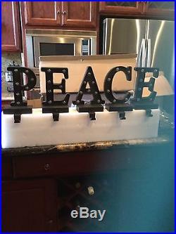 POTTERY BARN Lit Bronze WORD Stocking Holder Peace NEW HTF